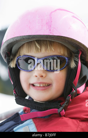 4 Year Old Girl Wearing a Ski Helmet, North Vancouver, B.C. - Stock Photo