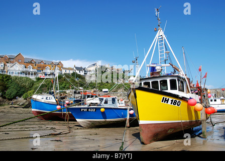 fishing boats at low tide in newquay harbour,cornwall,uk - Stock Photo