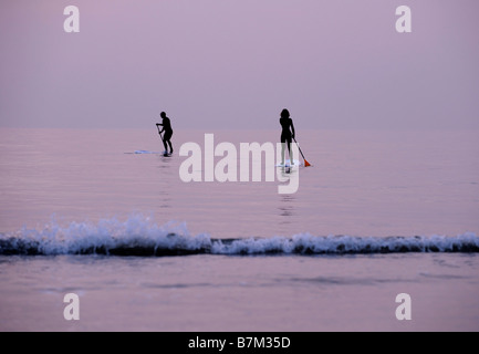 Stand up paddle boarding off the Brighton beach on East Sussex. Picture by Jim Holden. - Stock Photo
