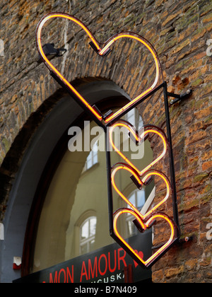 Neon heart sign above a shop off the main square of Krakow, Poland. - Stock Photo