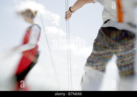 2 sailors sailing a yacht - Stock Photo