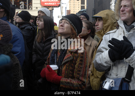 Thousands of people gather in Times Square in New York on Tuesday January 20 2009 to watch the inauguration of Barack - Stock Photo