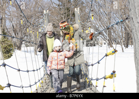 Family using play equipment - Stockfoto