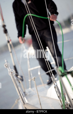 man hosing his yacht down after a voyage - Stockfoto