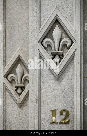 Fleur de lys symbol of quebec painted on the face of a for Chambre de commerce quebec