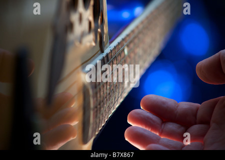 A guitar being played - Stockfoto
