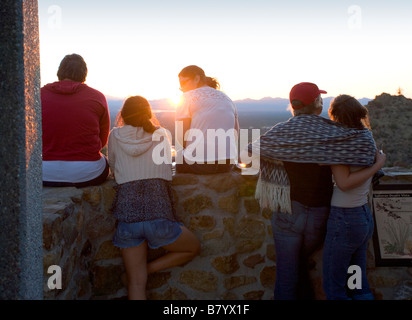 Tourists watching the sunset from the overlook at Gates Pass Gates Pass is in Saguaro national Park in Tucson Arizona - Stock Photo