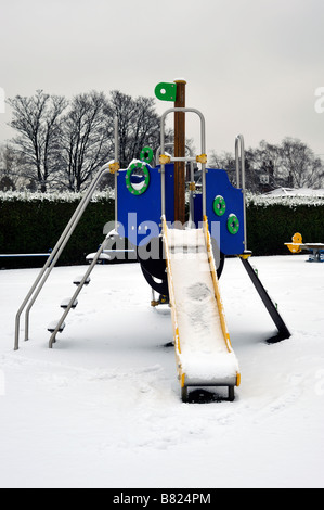 Play area covered in snow - Stock Photo