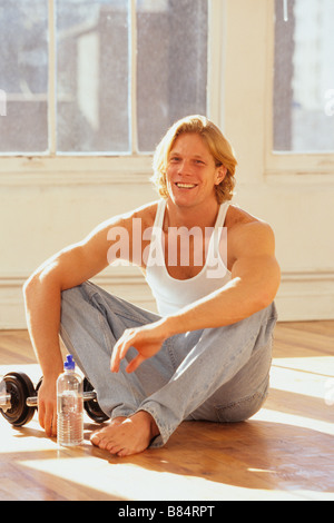 Portrait of young male during exercise session - Stock Photo