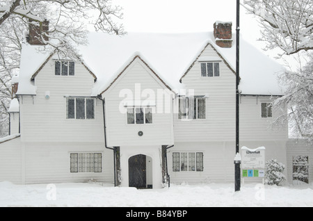White Hall covered in snow: 16th century timber framed and weather boarded house, now a museum, Cheam, south London, - Stock Photo