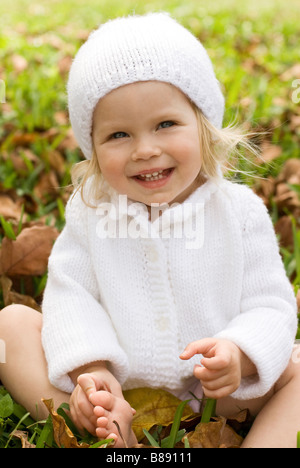 child in winter hat laughing - Stock Photo