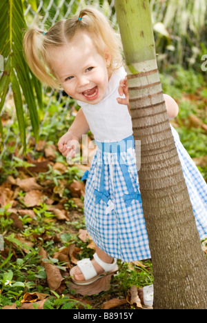 little girl playing hide & seek - Stock Photo