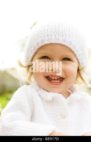 child in winter hat laughing - Stockfoto