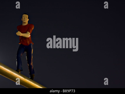 Sculpture called 'Walking Man' by Jonathan Borofsky illuminated by the Full Moon.  Museum of Fine Arts, Boston, - Stock Photo