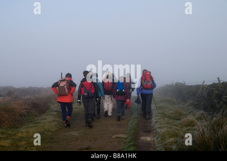 Misty weather condition and walkers in the Derbyshire Peak District National Park England - Stock Photo