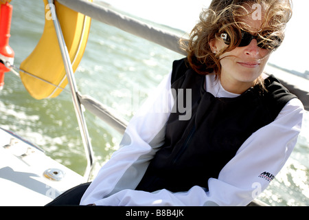 white European female sailing a yacht. - Stock Photo