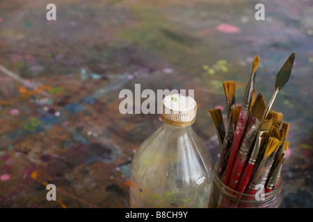 Artist's Paint Brushes and Bottle by Palette - Stockfoto