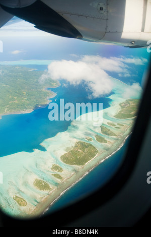 Airplane over society islands - Stock Photo