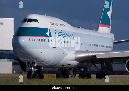 Cathay Pacific Airways Boeing 747-467 taxiing for departure at London Heathrow airport. - Stock Photo