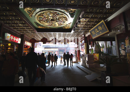 Crowds gather in the markets of old Shanghai, China to go shopping. A tourist attraction throughout Asia, people - Stock Photo