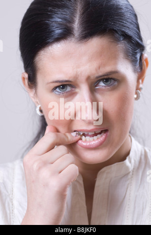Woman with toothache looking at camera - Stock Photo