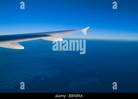Airplane Wing With Blue Sky, Clouds & Horizon - Stock Photo