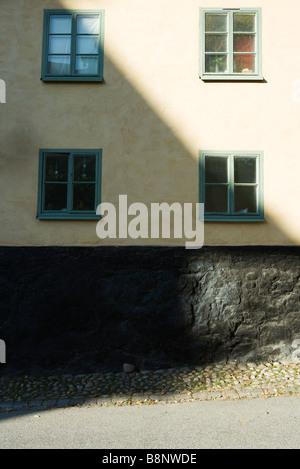 Sweden, Stockholm, building half in shadow - Stock Photo