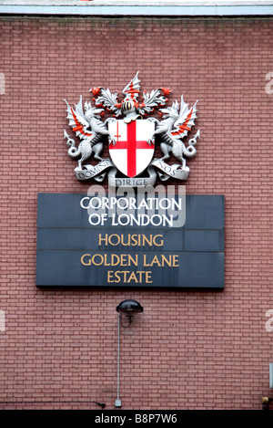 The Corporation of London coat of arms at the entrance to the Golden Lane housing estate, London. Feb 2009 - Stock Photo