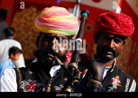 Rajasthani's playing the pipes at the Bikaner Camel Festival, Rajasthan, India - Stock Photo