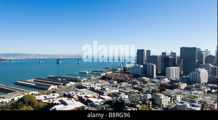The Oakland Bay Bridge and financial district from the top of the Coit Tower on Telegraph Hill, San Francisco, California - Stock Photo