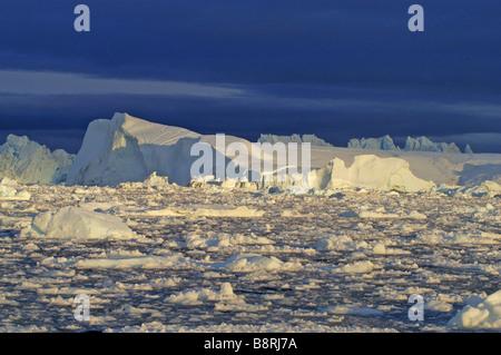 iceberg at night, Greenland - Stock Photo