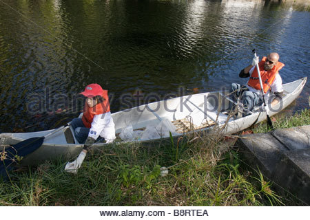 Little Boy Helping His Parents Work In Vegetable Garden
