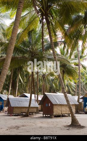 India Andaman and Nicobar Havelock island sunrise resort tourist accommodation below palm trees - Stock Photo