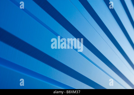 Waved blue metal sheet pattern on sunset. - Stock Photo