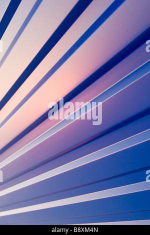Waved blue metal sheet pattern on sunset. - Stock Photo