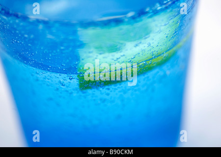 Water in a blue glass close-up. - Stock Photo