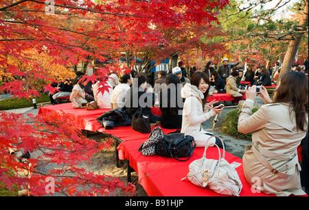 People enjoying the autumn colours at Eikando zen garden in Kyoto Japan - Stock Photo