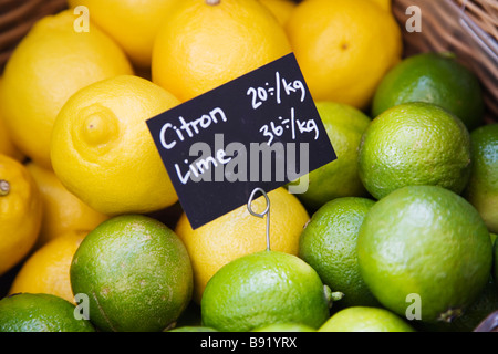 Lemons and lime fruits close-up. - Stock Photo