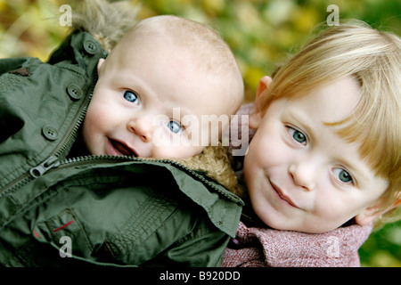 A sister with her baby brother Sweden. - Stock Photo