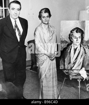 Indian Prime Minister Indira Gandhi right near her portrait that was painted by Dmitry Nalbandyan left during his - Stock Photo