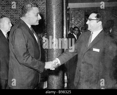 Egyptian President Gamal Abdel Nasser left greets Doctor of Philology and Arabic language professor Grigory Sharbatov - Stock Photo