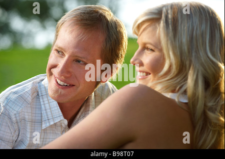 Couple lying in park - Stock Photo