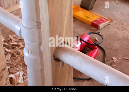 Rough plumbing pipes and drain installed in a wall at for New construction plumbing rough in