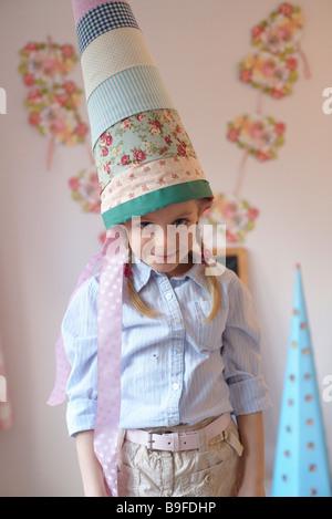 girl with a cardbone cone, portrait - Stockfoto