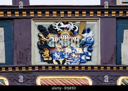 Medieval coat of arms on a half-timbered house, colourfully painted, former cathedral provost, Halberstadt, Harz, - Stock Photo