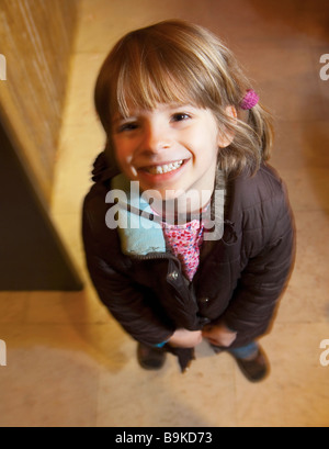 Girl smiling from high angle - Stock Photo