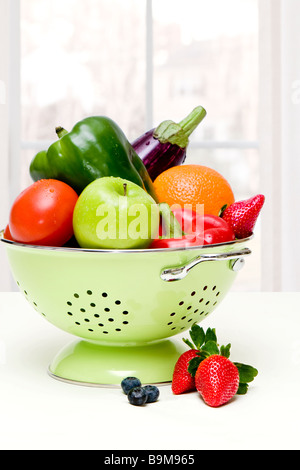 Fresh vegetables in a colander - Stock Photo