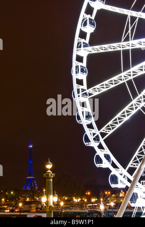 Big Wheel of the Place de la Concorde and the Eiffel tower at night, Paris, France, Europe - Stock Photo