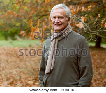 A portrait of a senior man in autumn time - Stock Photo