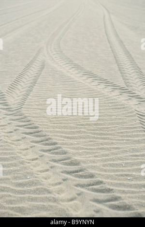 Tire tracks on sand - Stock Photo